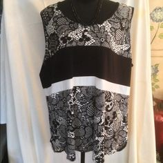 Sleeveless Tunic BEAUTIFUL SZ 2x  Gorgeous black and white sleeveless top. Brand new with tag. Great for summer. Can be dressed up with a necklace and earrings, a skirt or slacks with heels or dressed down with shorts and sandals or clogs.  Size is 2x. Great addition to your wardrobe. Worthington Tops Tunics