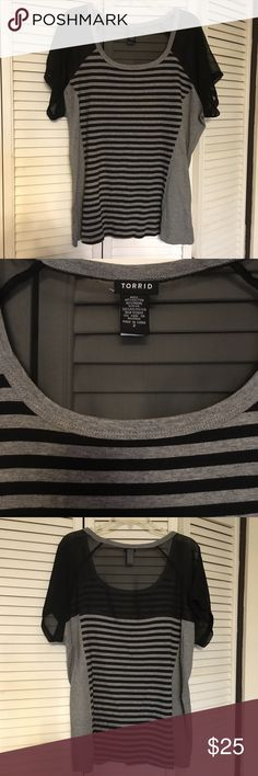 Torrid Striped Knit Top EUC - Black and gray Striped With sheer Back & Shoulders. The stretchy knit has a relatively conservative quality. But the cutout back  - will have you and everyone else watching your back. torrid Tops