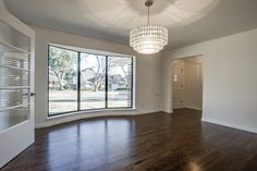 open floor plan living and dining rooms with modern finishes