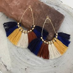 Chunky fringe tassel earrings Color:  Navy, blue, yellow, brown, ivory  Size: Hoop 3x4cm( approx 1.5x1.2inches) Fringe length 3cm( 1.2inches )  Materials: Brass with gold plated. Cotton threads Selected the durable and lasting plating hoops  It can also make in silver color(rhodium plated ) too.  Allergy free silicon hook is also available. Please select from drop down menu  Shipping: Japan post ( without tracking)  Production time: 7days working day (Saturday Sunday is no shipping m(_ _)m…