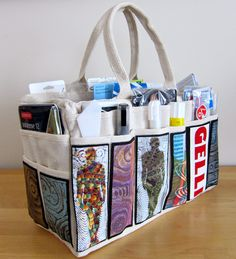 This is an awesome idea for a mobile art bag! Just a canvas tote from Harbor Freight, but decorated and stuffed full of fun stuff.