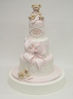 Three tier princess christening cake with modelled teddies