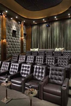 home theater room with Chesterfield leather seating by Decoholic