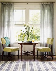 Two comfortable chairs with a table between for a game or a Coffee Klatsch. all in front of a magnificent window and drapes. I like the IDEA of this in a grand living room over this specific decor! Living Room Chairs, Living Room Furniture, Living Room Decor, Dining Room, Dining Chairs, Wood Chairs, Bag Chairs, Chess Table, A Table