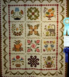 """Jo and Friends in the """"Heartland"""" by Sue Maitre, quilted by Linda Hrcka. Design by Pearl Pereira; photo by Quilt Inspiration"""