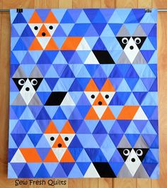 Fox raccoon triangle quilt. Oh my god, this is too cute! Awesome idea