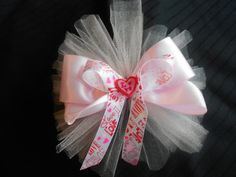 """Valentines Bow...ALL ABOUT LOVE, Valentine hair bow was made with Pink Tulle, 1 1/2in. Pink Satin ribbon, 7/8in. printed ribbon of """"LOVE"""" is tripled stacked with center button of love. It measures approv. 4½ to 5 inches across.  All ribbon has been heat sealed to prevent fraying, each layer is sewn then glued to secure. It is attached to a French barrette.  Price listed is for 1hairbow.  $8.00 with free shipping"""