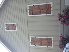 Saw this little house while on vacation...in LOVE with the shutters, hardware and siding!!!