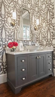 A bold wallcovering from Schumacher creates instant interest and drama in a guest bathroom. This space was designed by Emily Hewett of A Well Dressed Home. | Dallas Morning News. #classic #timeless lelandwallpaper.com loves Schumacher wallpapers Navy Blue Bathrooms, Bathroom Accessories, Bathroom Fixtures
