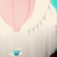 Items from IKEA hacked to create a gorgeous Hot Air Balloon decoration for parties.