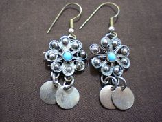 Upcycled/Recycled Bohemian style metal earrings with turquoise colored bead. $14.00, via Etsy.
