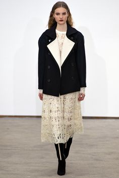 """Derek Lam Fall 2013 """"The Derek Lam look was an interesting mix of streamlining and craft, which meant sleek capes and well-cut pants interspersed with subtle patchworks on a bodice or a lace effect on the skirt. Wool fringe dangling from skirt hems added to the suggestion of California homespun handiwork in the 1970s."""""""