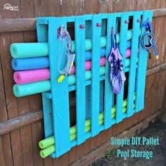 Simple Pallet Pool Storage – Juggling Act Mama - pool decor Piscina Pallet, Piscina Diy, Pallet Pool, Diy Pallet, Pallet Signs, Pool Toy Storage, Craft Storage, Pool Float Storage, Pallet Storage