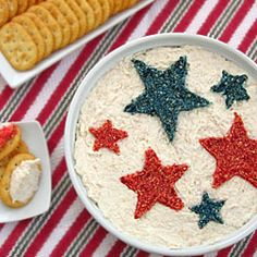 All you need are star shaped cookie cutters, something to cut (bread?) or sprinkle into the shape, and food coloring to decorate a dip for 4th of July.
