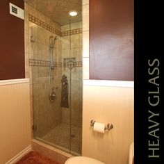 A Cast Glass Lighthouse pull in Bronze glass adds style to this enclosure. shower door