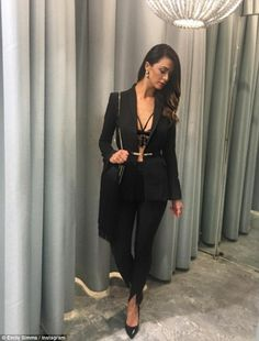 Style:  Emily Simms (pictured) flaunted her curves in a lace bralette and blazer for a coc...