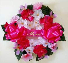 Great wreath for Mother's Day. Constructed with various pink and white flowers, and leafy greens. Adorned with two pink bows and a ribbon that says Mom. Grave Flowers, Memorial Flowers, Pink And White Flowers, Cemetery, Floral Wreath, Bouquet, Pink Bows, Wreaths, Memories