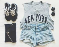 Gorgeous denim shorts with top grey new york printed cropped tee-shirt and gold studde black clutch and black soft shoes and black goggles t...