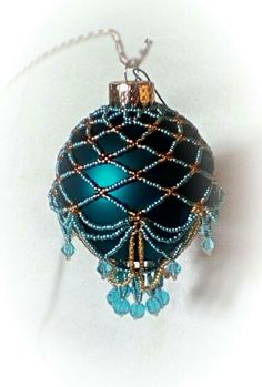 Blue and gold beaded Christmas ornament.