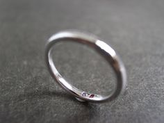 Simple band  https://www.etsy.com/listing/100398231/wedding-ring-with-ruby-and-amethyst-in