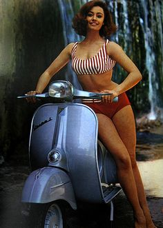 Vintage Vespa Whoops wrong vehicle class but nice lady...  http://riches.aktpromotions.net/