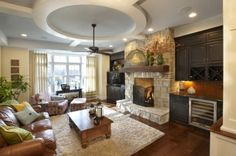 Great family entertaining room- beautiful built in cabinets/bar area in Starmark maple finished in Amaretto.