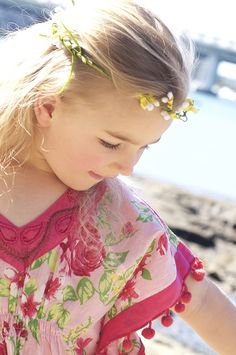 A gorgeous floral kaftan with touches of rose pink & mint on a pale pink…