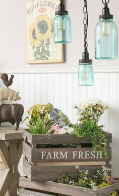 So cute! I love the crates and the antique jars turned light fixtures!