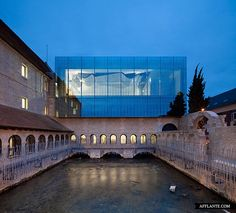 French architects Opus 5 have recently completed construction of a concert hall on top of a former seventeenth century convent in northern France. The monastery was built between 1646 and 1659.