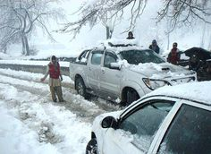CHITRAL: February 06 -  A view of vehicles stuck in snow covered area during heavy snowfall in the city.