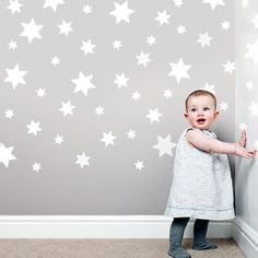 49 white star wall stickers made of award winning reusable adhesive fabric. Our wall decals are removable and repositionable! Use on ceiling, mirrors, glass, lampshades and more! Simply peel and stick