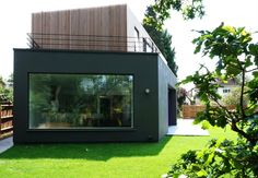 Wedge House - External view towards picture window within Living space