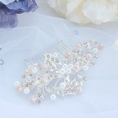 Check out this item in my Etsy shop https://www.etsy.com/listing/602286705/floral-wedding-bridal-hair-accessory
