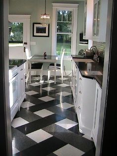 here's another idea -- black, white and grey tiles laid in a slight plaid pattern.  Easily done.