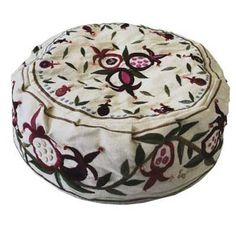 The elegant pattern of leaves a pomegranates, a symbol of the Holy City as well as abundance and success, is embroidered using silk threads on soft raw white cotton fabric.