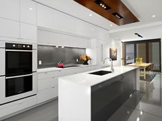 Modern Small White Kitchen with Stainless Steel Features