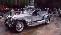 """Rolls-Royce Silver Ghost at Centenary. TheRolls-Royce Silver Ghostrefers both to a car model and to one specific car from that series.  Originally named the """"40/50 h.p."""" thechassiswas first made at Royce'sManchesterworks, with production moving toDerbyin July 1908, and also, between 1921 and 1926, inSpringfield, Massachusetts. Chassis no. 60551, registeredAX 201, was the car that was originally given the name """"Silver Ghost."""""""