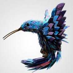 r Sean Avery  artist shatters old CD's to make incredible animal sculptures.
