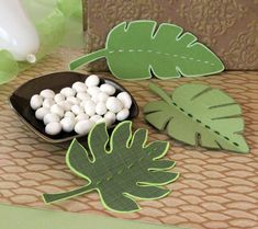 Inspired by the lush green rainforest where the worry-free duo Timon and Pumbaa reside, these leafy place card/shower decorations double as take-home bookmarks. Jungle Theme Parties, Jungle Party, Safari Party, Baby Party, Lion King Theme, Lion King Party, Lion King Birthday, Jungle Decorations, Lion King Baby Shower