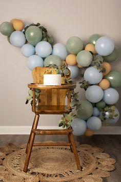 Boho high chair balloon garland cake smash for first birthday photos