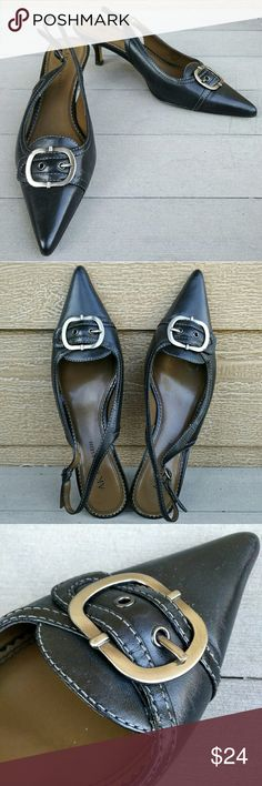 Pointy-toed slingbacks Black leather with contrast stitching and silver buckle. Minimal wear - see photo for details. True to size. Anne Klein Shoes Mules & Clogs