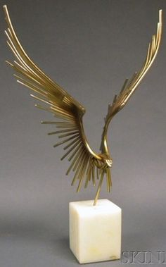 Curtis Jere brass and onyx eagle sculpture, 1978. The brass rod composition in the form of an eagle with wings in flight, mounted on a tall stone plinth, copyright mark Jere and dated 1978.