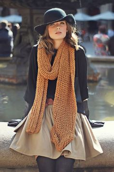 chunky knit scarf black top neutral skirt black hat black tights black gloves dressy casual