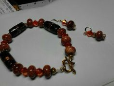 this is made with goldstone beads, copper glass beads and orange swarovski crystals with matching earrings.  for sale