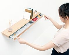 Modern bookshelf with integrated hidden drawer for your money, passport, jewelry, stamps, and other valuables.      Designed by Japanese company Torafu, wooden bookshelf contains secret metal drawer that can only be opened with magnetic keys.