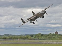Photo of B-25 Mitchell (N320SQ) banking right ✈ FlightAware