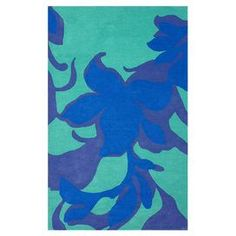 Hand-carved wool rug with an abstract floral motif.   Product: RugConstruction Material: 100% WoolColor: BlueFeatures: Hand-carvedNote: Please be aware that actual colors may vary from those shown on your screen. Accent rugs may also not show the entire pattern that the corresponding area rugs have.Cleaning and Care: Spot treat with mild detergent and water. Professional cleaning is recommended if necessary.
