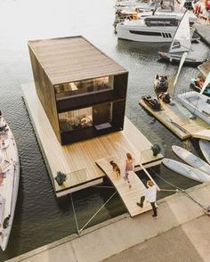 This Tiny House Can Be Built in One Day—And it Floats on WaterIt's definitely not your average house boat. It's definitely not your average house boat. Prefab Cabins, Prefab Homes, Modern Tiny House, Tiny House Design, Houseboat Living, Modular Housing, Salons Cosy, Wooden Terrace, Water House