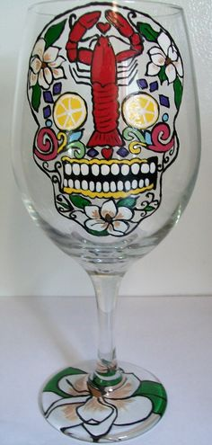 Will be having a crawfish boil someday!! I will also be painting these Crawfish Sugar Skull painted wineglasses for the guests :)))