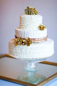 Three tier wedding cake with gold accents by Nothing Bakes Like a Parrott |  photography by http://corbingurkin.com/